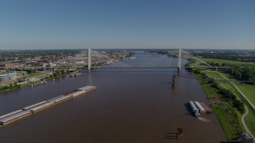 5.7K stock footage aerial video of a reverse of barges on the river and a cable-stayed bridge, St. Louis, Missouri Aerial Stock Footage | DX0001_000590