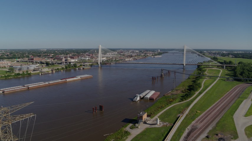 5.7K stock footage aerial video of barges in the river and a cable-stayed bridge, St. Louis, Missouri Aerial Stock Footage | DX0001_000591