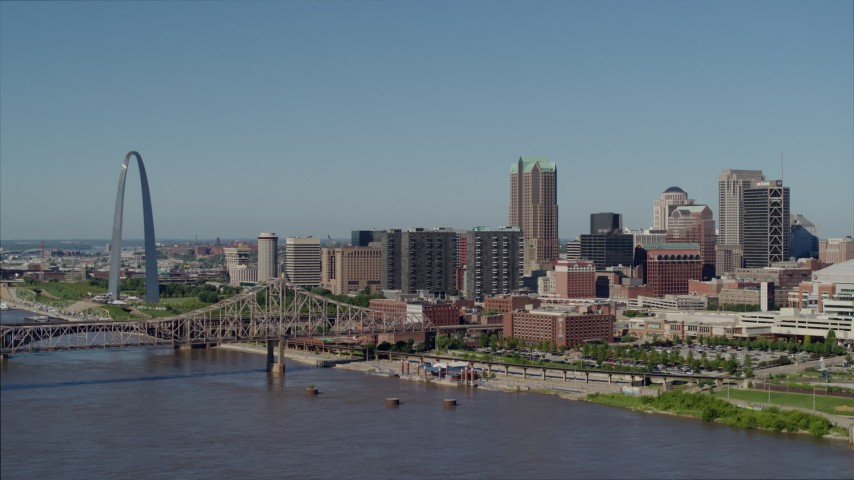 5.7K stock footage aerial video approaching riverfront office buildings near a bridge with Arch in the background, Downtown St. Louis, Missouri Aerial Stock Footage | DX0001_000592