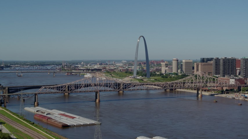 5.7K stock footage aerial video of a view of the Gateway Arch across the river in Downtown St. Louis, Missouri, seen from East St. Louis Aerial Stock Footage | DX0001_000596