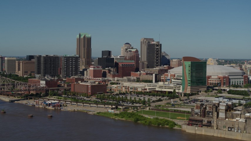 5.7K aerial video of approaching Downtown St. Louis, Missouri skyscrapers and hotels while crossing the Mississippi River Aerial Stock Footage | DX0001_000598