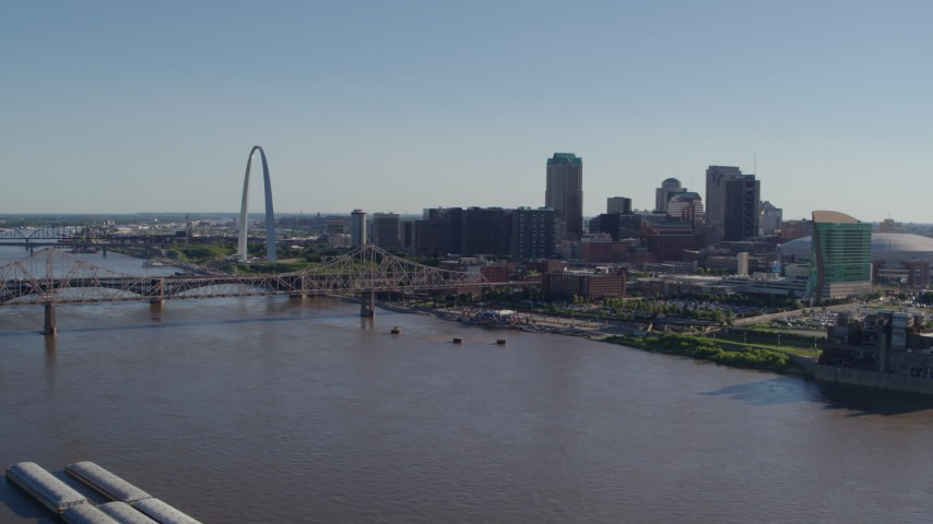 5.7K stock footage aerial video of the Gateway Arch and skyscrapers seen from across the river, Downtown St. Louis, Missouri Aerial Stock Footage | DX0001_000643
