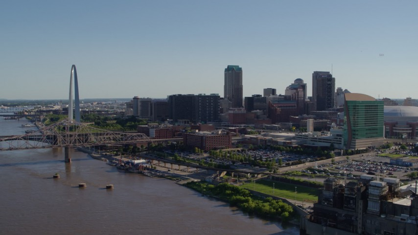 5.7K stock footage aerial video of a reverse view of the Arch and downtown buildings from the river, Downtown St. Louis, Missouri Aerial Stock Footage | DX0001_000645