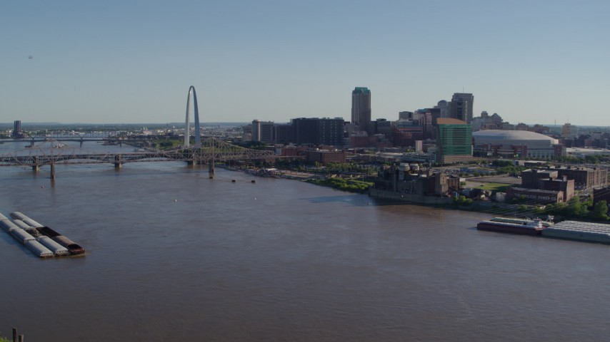 5.7K stock footage aerial video of flying over the river toward Downtown St. Louis, Missouri Aerial Stock Footage | DX0001_000650