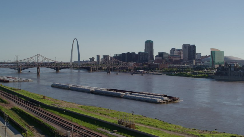 5.7K stock footage aerial video of Downtown St. Louis, Missouri seen from train tracks in East St. Louis, Illinois Aerial Stock Footage | DX0001_000655