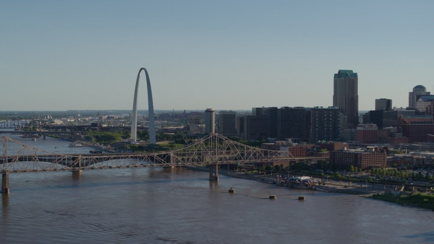 5.7K aerial video of the famous Arch behind the bridge in Downtown St. Louis, Missouri Aerial Stock Footage | DX0001_000656