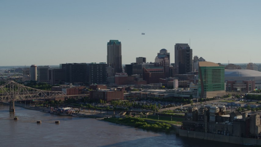 5.7K aerial video flying away from downtown to reveal the Gateway Arch in Downtown St. Louis, Missouri Aerial Stock Footage | DX0001_000659