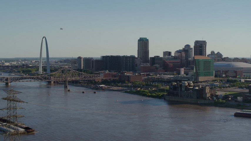 5.7K aerial video flying over the river to approach hotels and Downtown St. Louis, Missouri Aerial Stock Footage | DX0001_000661