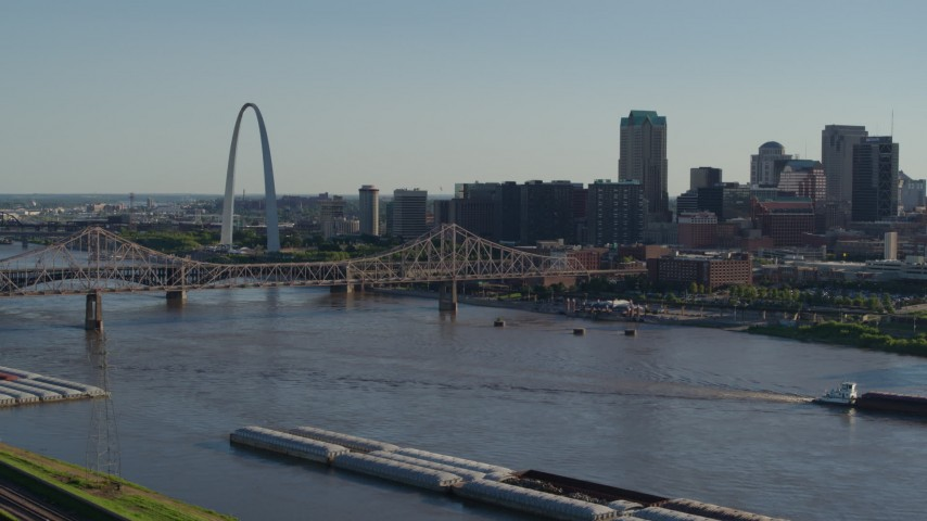 5.7K stock footage aerial video ascend to reveal the Gateway Arch and Downtown St. Louis, Missouri across the river Aerial Stock Footage | DX0001_000667