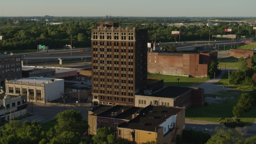 5.7K aerial video of an abandoned brick building at sunset in East St. Louis, Illinois Aerial Stock Footage | DX0001_000669