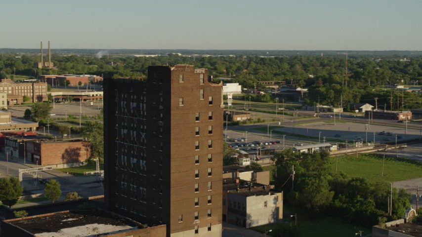 5.7K stock footage aerial video orbiting the top of an abandoned office building at sunset in East St. Louis, Illinois Aerial Stock Footage | DX0001_000671