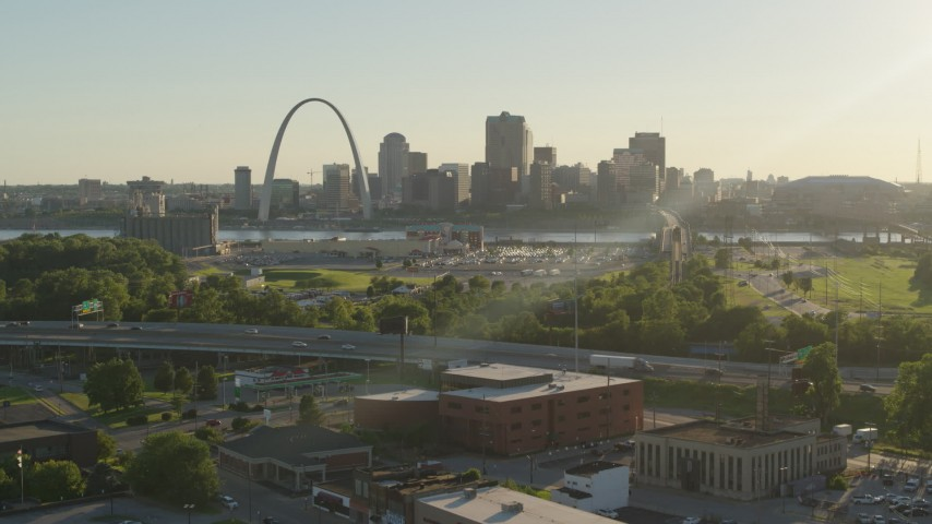 5.7K stock footage aerial video fly over brick building at sunset toward Gateway Arch and Downtown St. Louis, Missouri Aerial Stock Footage DX0001_000679 | Axiom Images