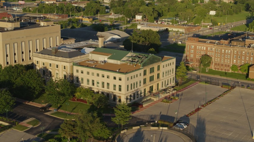 5.7K stock footage aerial video of approaching a federal courthouse at sunset in East St. Louis, Illinois Aerial Stock Footage DX0001_000685 | Axiom Images