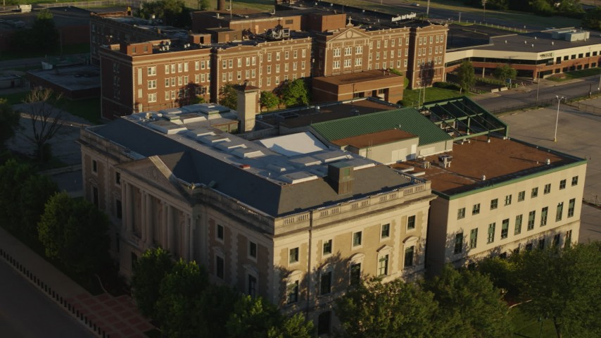 5.7K aerial video of circling a federal courthouse at sunset in East St. Louis, Illinois Aerial Stock Footage   DX0001_000687