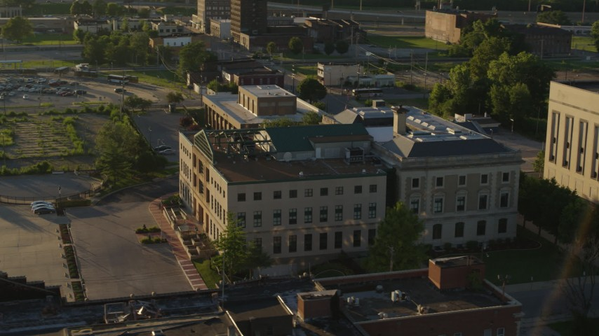 5.7K stock footage aerial video of circling around a federal courthouse at sunset in East St. Louis, Illinois Aerial Stock Footage | DX0001_000690