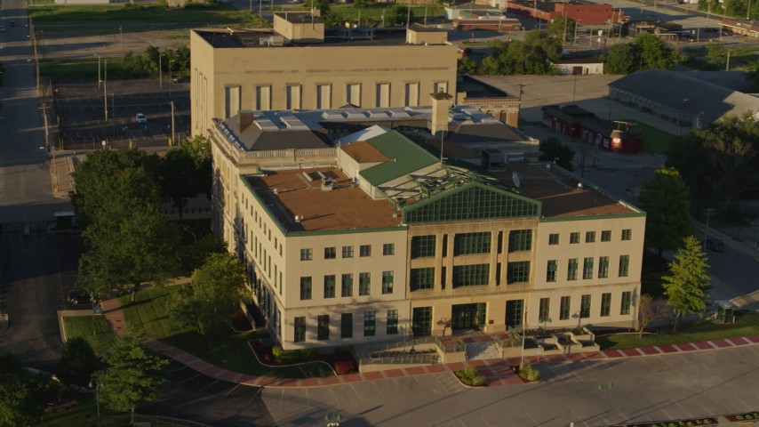5.7K stock footage aerial video circle and fly away from a federal courthouse at sunset, East St. Louis, Illinois Aerial Stock Footage | DX0001_000692