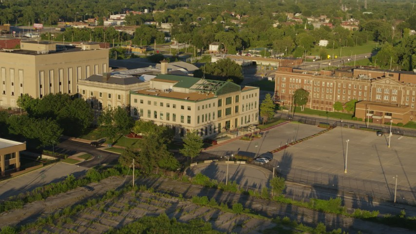 5.7K aerial video of flying from a federal courthouse at sunset in East St. Louis, Illinois Aerial Stock Footage | DX0001_000693