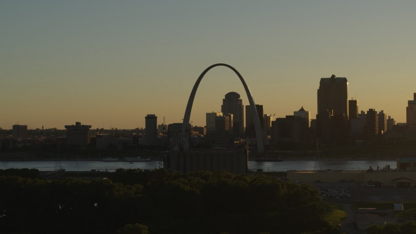 5.7K stock footage aerial video of a view across the river at Gateway Arch and Downtown St. Louis, Missouri at sunset Aerial Stock Footage | DX0001_000699