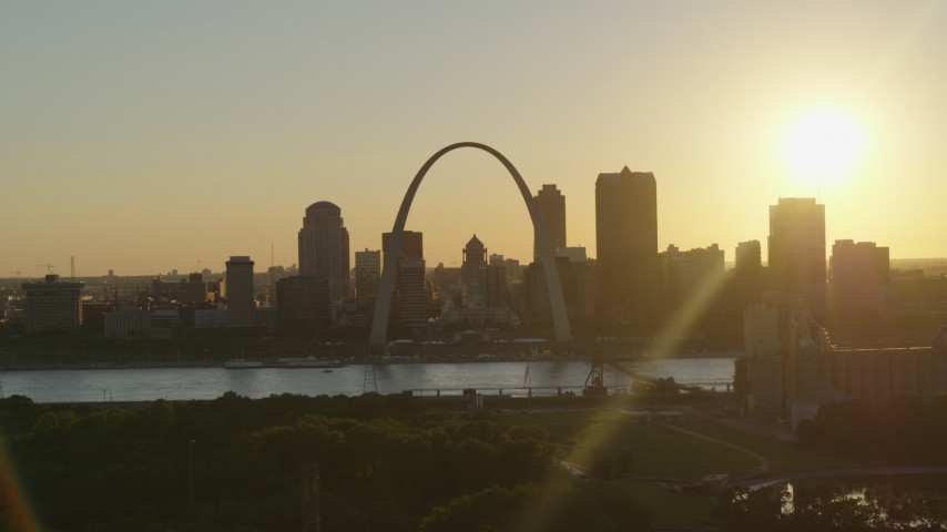5.7K stock footage aerial video the Arch and Downtown St. Louis, Missouri skyline with setting sun in background Aerial Stock Footage | DX0001_000701
