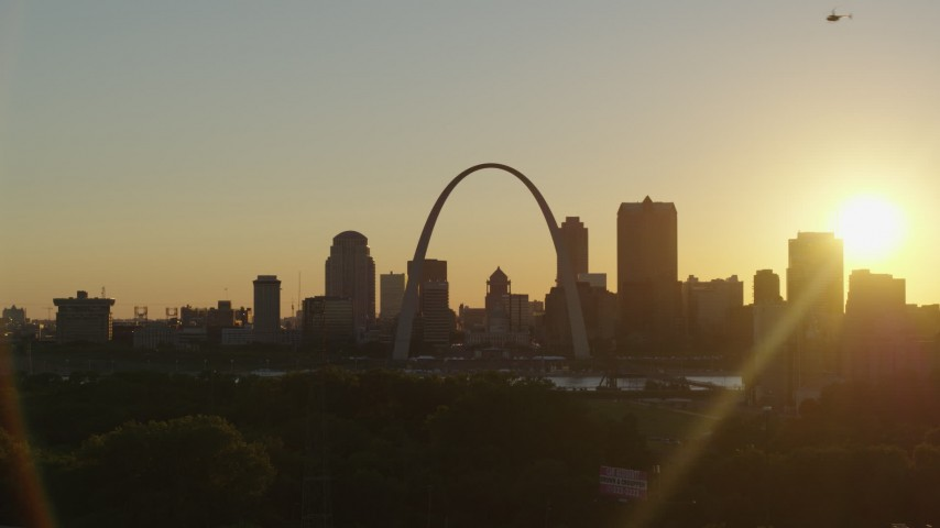 5.7K stock footage aerial video of the Gateway Arch and Downtown St. Louis, Missouri skyline at sunset while descending Aerial Stock Footage | DX0001_000711