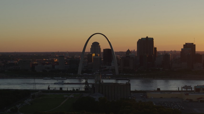 5.7K stock footage aerial video a view across the river of the Gateway Arch and Downtown St. Louis, Missouri at sunset Aerial Stock Footage | DX0001_000714