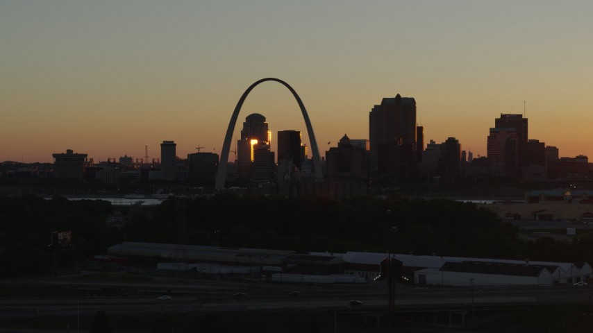 5.7K aerial video ascend and approach the Gateway Arch in Downtown St. Louis, Missouri at sunset Aerial Stock Footage | DX0001_000720