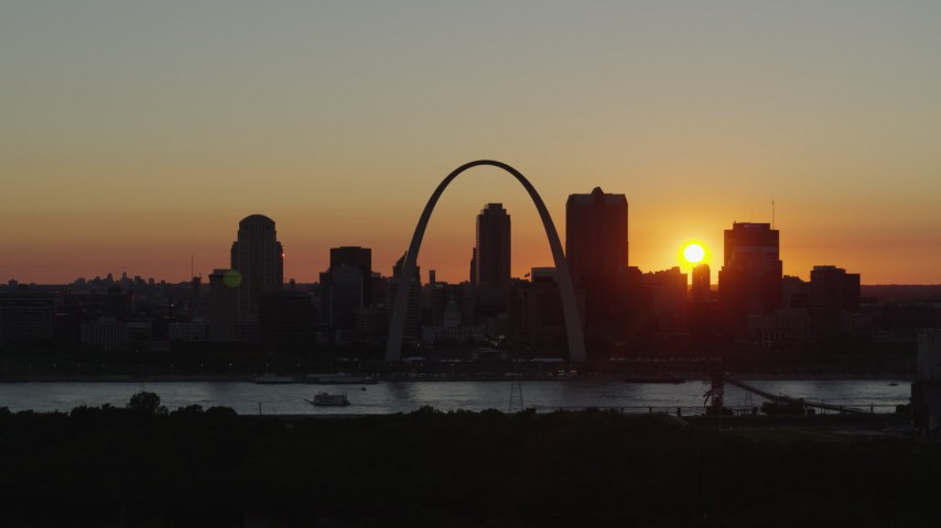 5.7K stock footage aerial video of the Gateway Arch and the Downtown St. Louis, Missouri skyline in silhouette at sunset Aerial Stock Footage | DX0001_000725