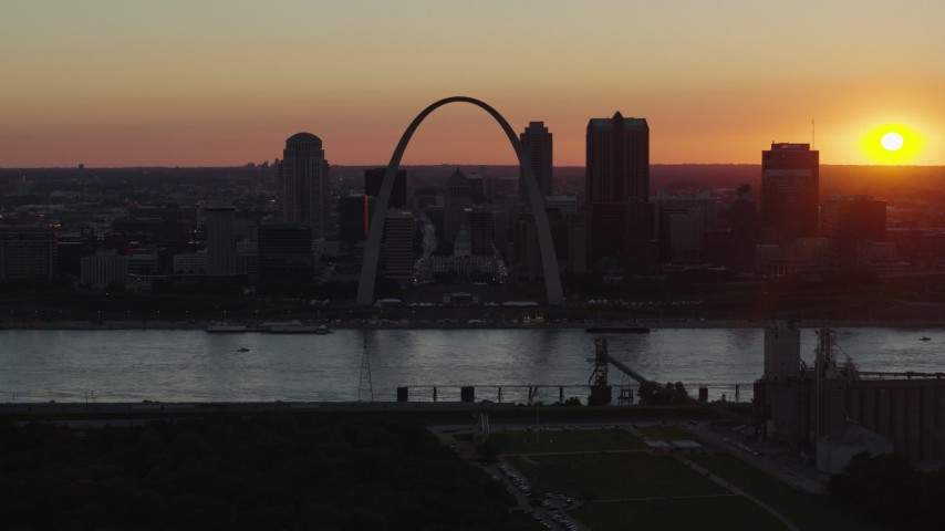 5.7K stock footage aerial video of the Gateway Arch in silhouette in Downtown St. Louis, Missouri, sunset Aerial Stock Footage | DX0001_000729
