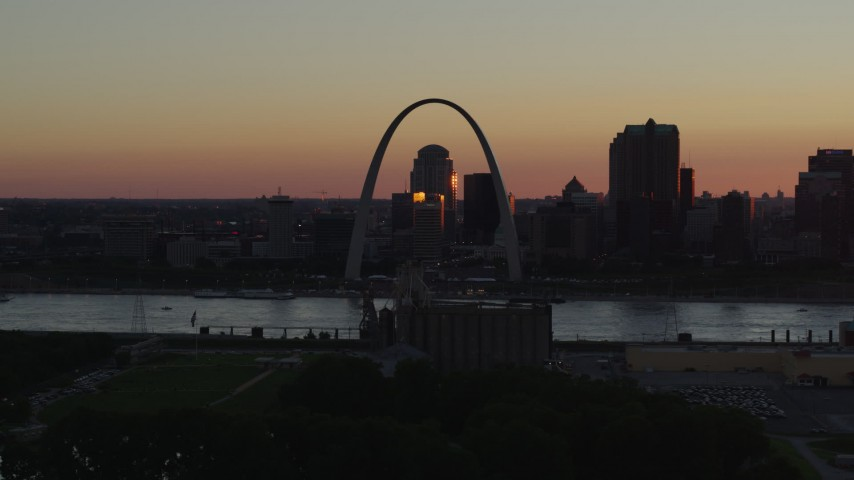 5.7K aerial video flyby the Gateway Arch and Downtown St. Louis, Missouri in silhouette at sunset Aerial Stock Footage | DX0001_000730