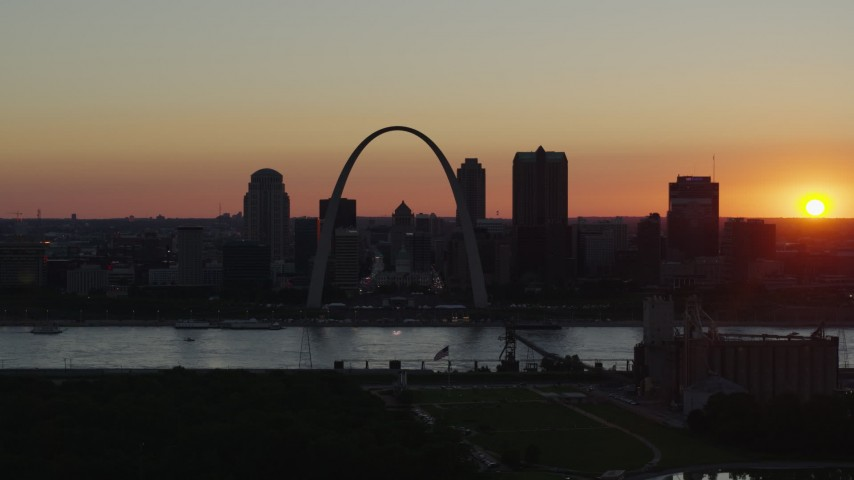 5.7K stock footage aerial video of the Downtown St. Louis, Missouri skyline in silhouette at sunset Aerial Stock Footage DX0001_000733 | Axiom Images