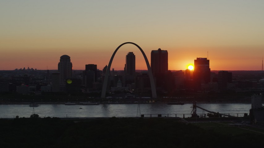 5.7K stock footage aerial video of the sun setting behind Downtown St. Louis, Missouri and the Gateway Arch Aerial Stock Footage | DX0001_000734