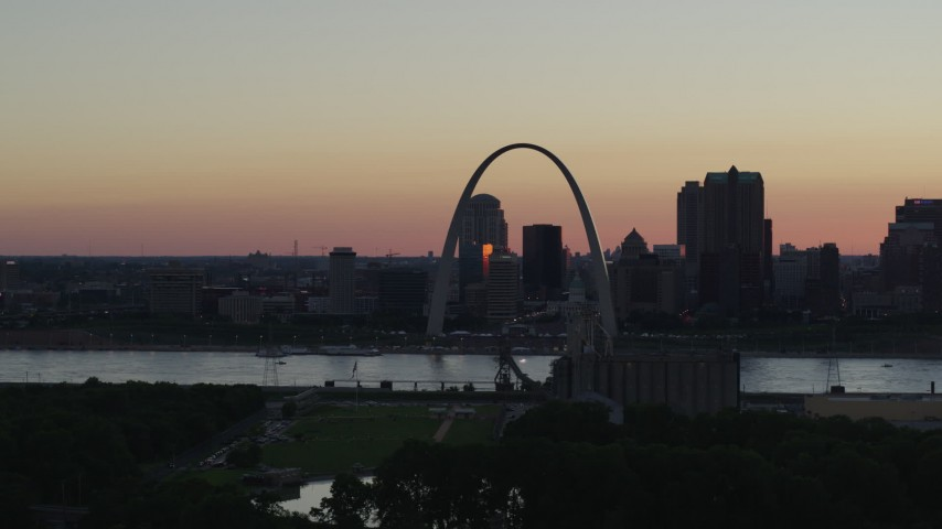 5.7K stock footage aerial video of looking across the river at the Gateway Arch and Downtown St. Louis, Missouri, sunset Aerial Stock Footage | DX0001_000737