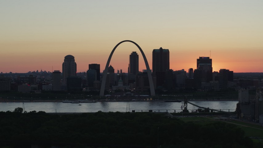 5.7K stock footage aerial video of Downtown St. Louis, Missouri at sunset, seen from Illinois Aerial Stock Footage | DX0001_000738