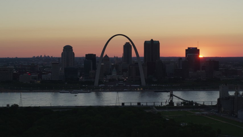 5.7K stock footage aerial video slow flyby of Gateway Arch and Downtown St. Louis, Missouri, sunset Aerial Stock Footage | DX0001_000739