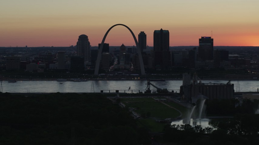5.7K stock footage aerial video the Downtown St. Louis, Missouri, skyline seen from Gateway Geyser at twilight Aerial Stock Footage | DX0001_000743
