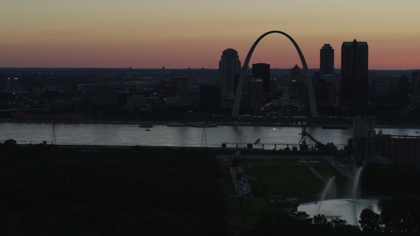 5.7K stock footage aerial video of the city skyline in silhouette, Downtown St. Louis, Missouri, twilight Aerial Stock Footage | DX0001_000747