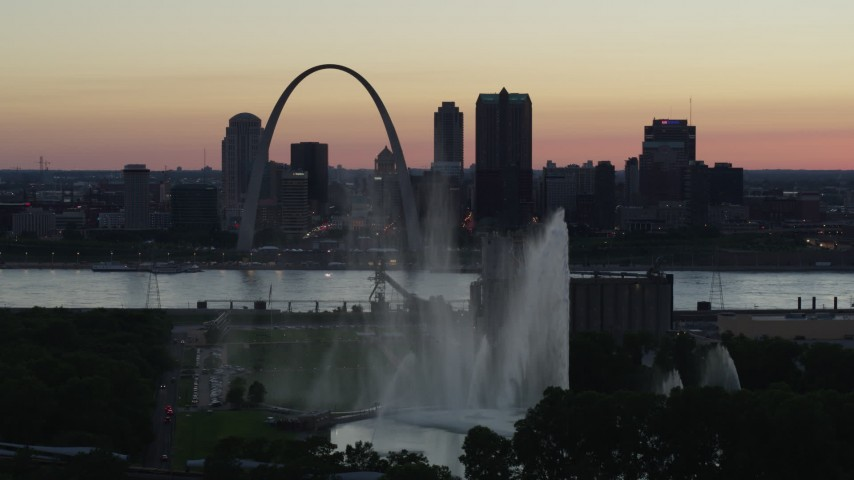 5.7K aerial video of the Gateway Geyser and Arch, Downtown St. Louis, Missouri, twilight Aerial Stock Footage | DX0001_000749