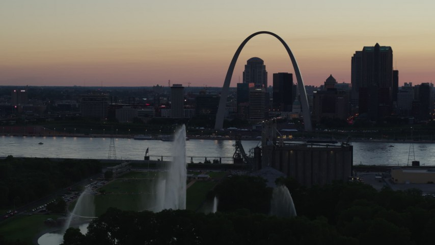 5.7K aerial video water from Gateway Geyser and the Gateway Arch, Downtown St. Louis, Missouri, twilight Aerial Stock Footage | DX0001_000750