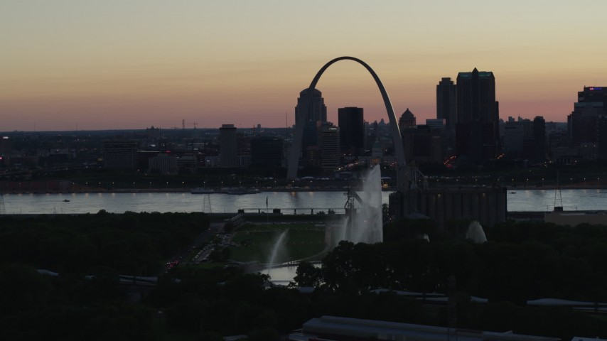 5.7K stock footage aerial video fly away from Gateway Geyser, with view of Downtown St. Louis, Missouri, twilight Aerial Stock Footage | DX0001_000752