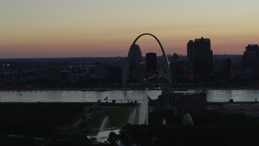 5.7K stock footage aerial video a reverse view of the Gateway Geyser, and the Arch in Downtown St. Louis, Missouri, twilight Aerial Stock Footage | DX0001_000756