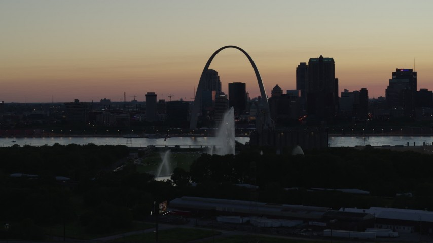 5.7K aerial video a static view of the Gateway Geyser, and the Arch in Downtown St. Louis, Missouri, twilight Aerial Stock Footage | DX0001_000757