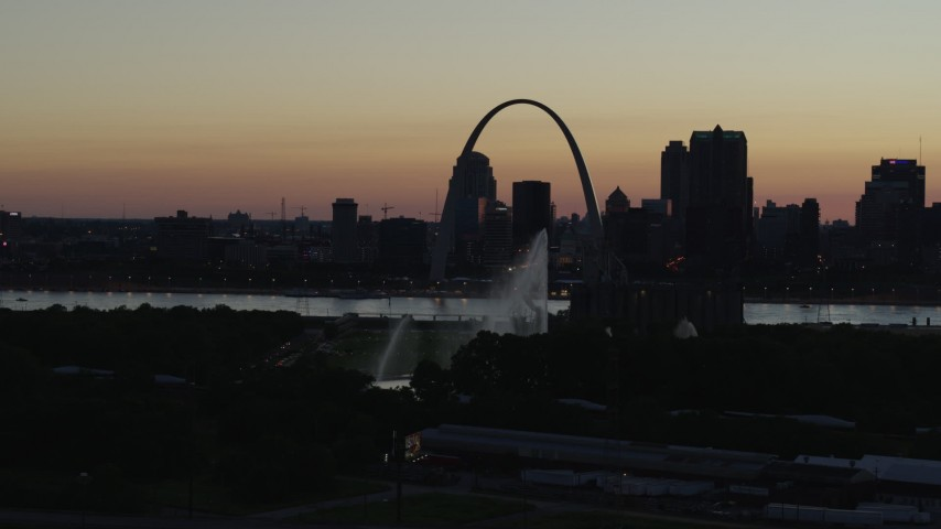 5.7K stock footage aerial video fly way from Gateway Arch in Downtown St. Louis, Missouri, twilight, and the Gateway Geyser Aerial Stock Footage | DX0001_000759