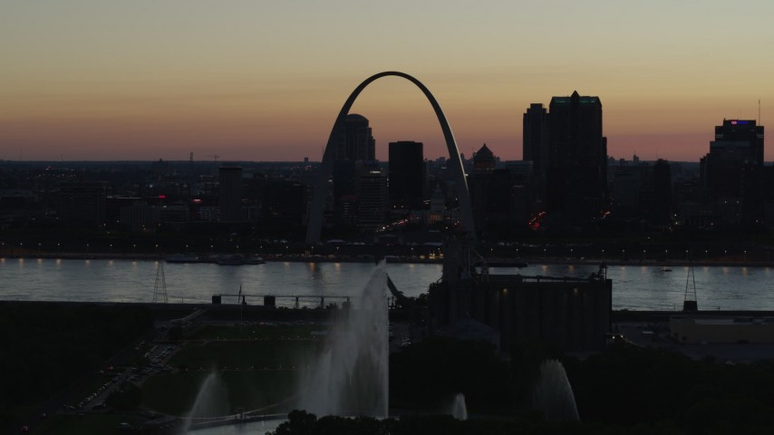 5.7K stock footage aerial video approach Gateway Geyser and the Arch across the river, Downtown St. Louis, Missouri, twilight Aerial Stock Footage | DX0001_000761