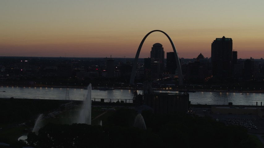 5.7K stock footage aerial video pass the Gateway Geyser with view of Downtown St. Louis, Missouri, twilight Aerial Stock Footage | DX0001_000763