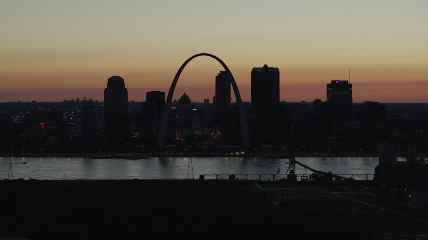 5.7K stock footage aerial video of a view across the river at Downtown St. Louis, Missouri, twilight Aerial Stock Footage | DX0001_000765