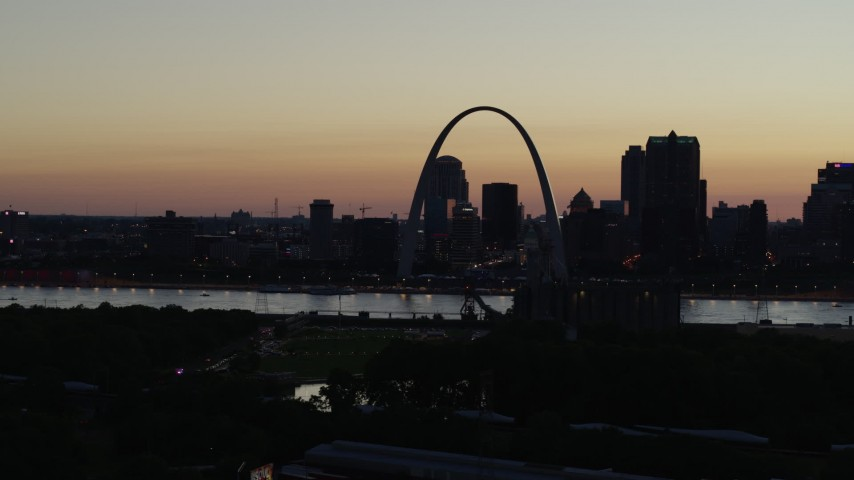 5.7K stock footage aerial video of passing the Downtown St. Louis, Missouri skyline in silhouette at twilight Aerial Stock Footage | DX0001_000767