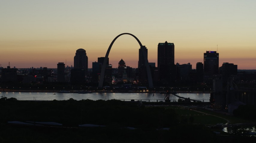 5.7K stock footage aerial video of Downtown St. Louis, Missouri, across the Mississippi River at twilight Aerial Stock Footage DX0001_000768