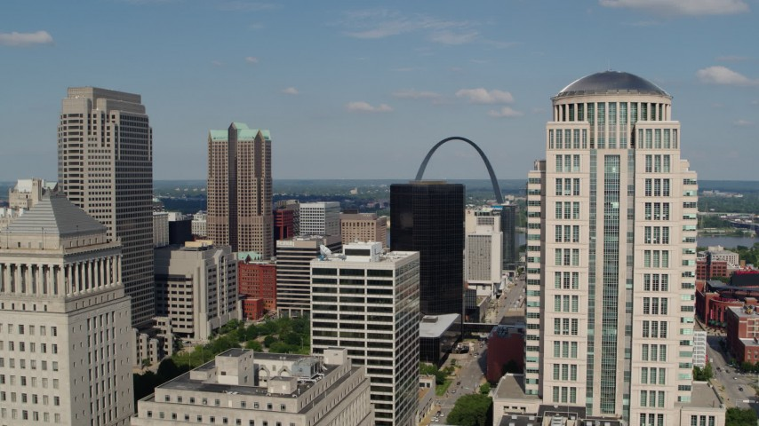 5.7K stock footage aerial video of a view across the city to the museum by the Gateway Arch in Downtown St. Louis, Missouri Aerial Stock Footage DX0001_000778 | Axiom Images