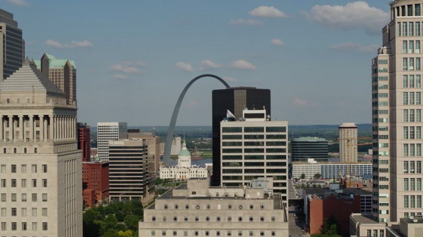 5.7K stock footage aerial video flyby courthouse tower with view of Arch, reveal the museum in Downtown St. Louis, Missouri Aerial Stock Footage | DX0001_000792