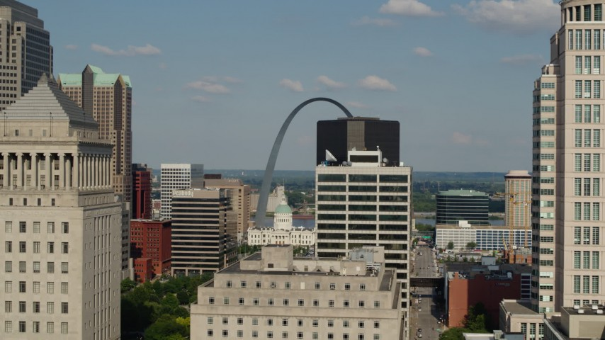 5.7K stock footage aerial video flyby high-rises to reveal the Museum at the Gateway Arch in Downtown St. Louis, Missouri Aerial Stock Footage | DX0001_000793
